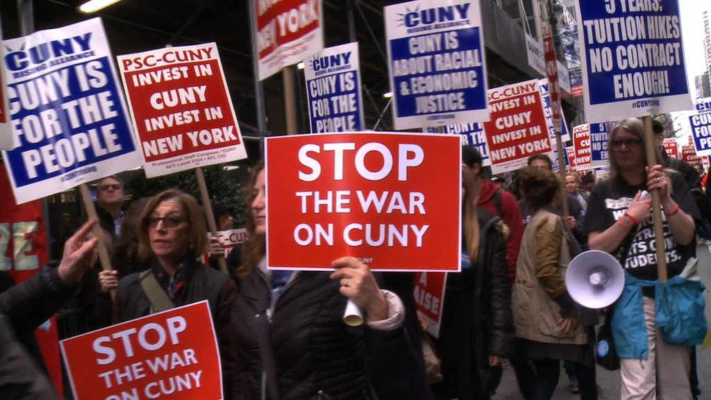 """Protest signs """"Stop the War on CUNY"""" and """"Invest in CUNY, Invest in NY"""" at protests against budget cuts to City University of New York"""