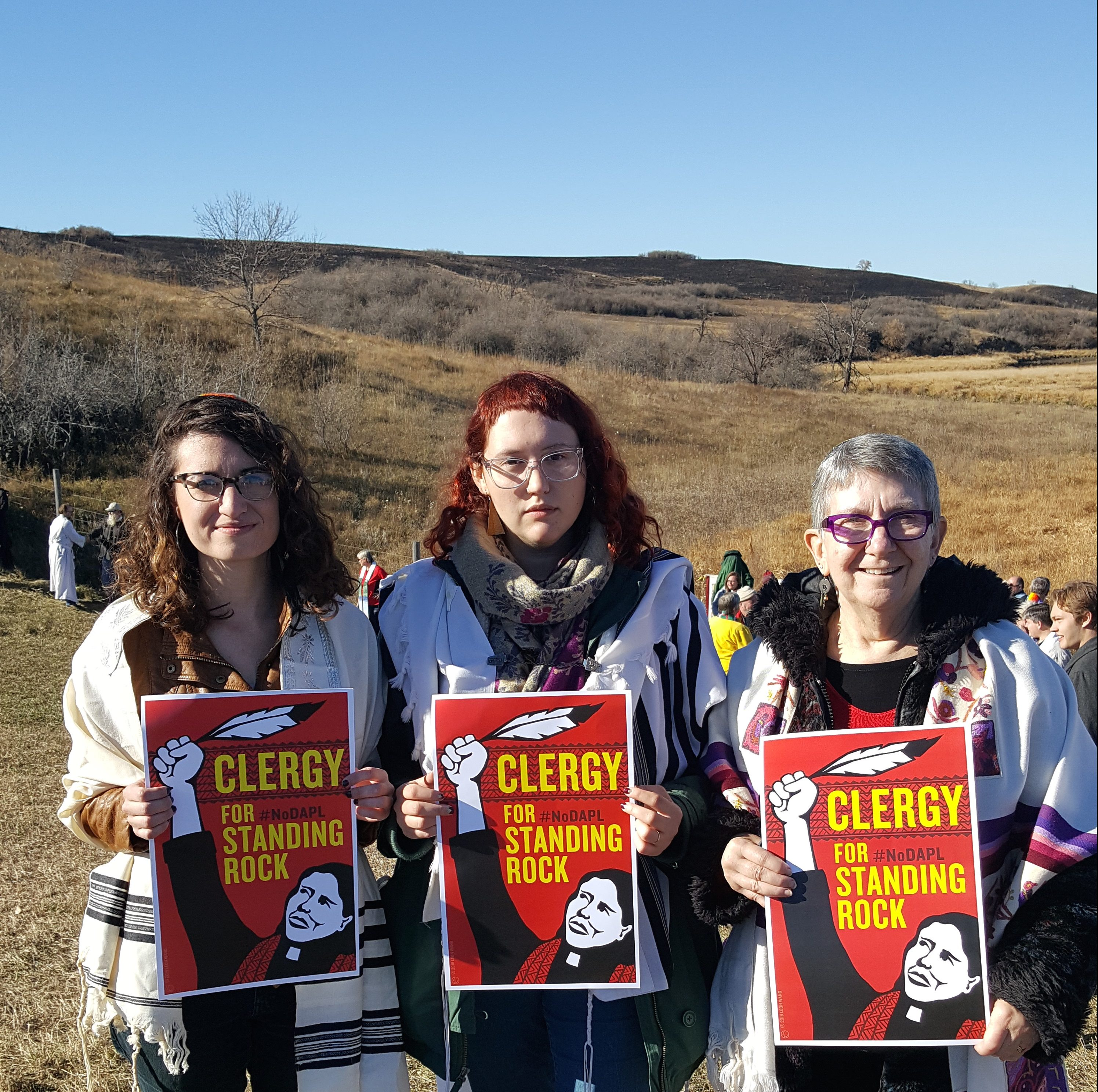 Rabbinical students Miriam Levia Grossman and Ariana Katz pose along with Rabbi Linda Holtzman during Clergy Day at Standing Rock reservation in support of the #NoDAPL protesters.