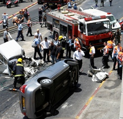 Four Murdered, Dozens Hurt